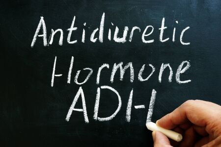 Antidiuretic hormone ADH or vasopressin sign on on the blackboard.