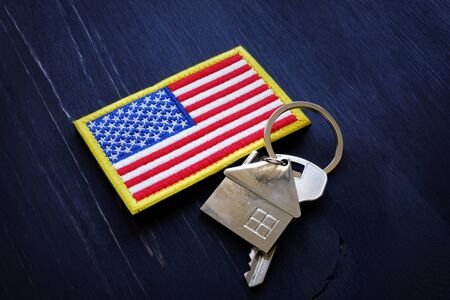 American flag and key from home. VA Streamline Refinance loan concept. Standard-Bild