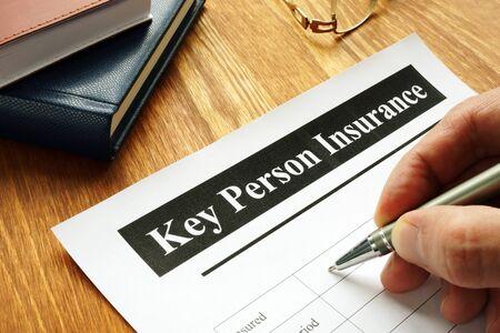 Key Person Insurance policy agreement on teble. Zdjęcie Seryjne