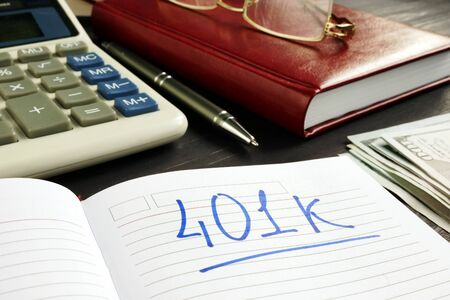 401k Retirement plan in the notebook and calculator. Stock Photo - 133242871