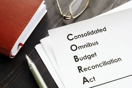 COBRA Consolidated Omnibus Budget Reconciliation Act on the desk. Stock fotó - 133404500