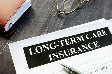 Long-Term Care Insurance agreement policy and notebook. Stock fotó - 133404502