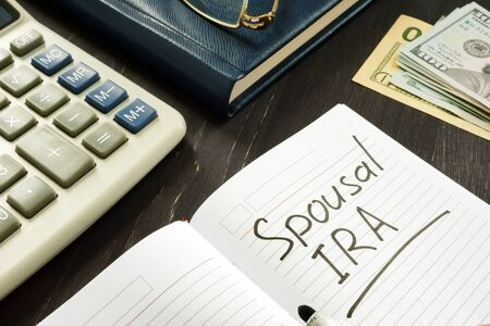 Spousal IRA inscription in the note. Retirement concept. Stock Photo
