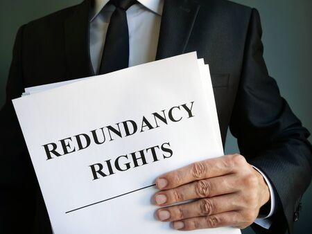 Man is holding Redundancy rights law.
