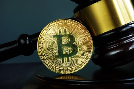 Gavel and Bitcoin coin. Crypto law and regulation of cryptocurrency. Zdjęcie Seryjne