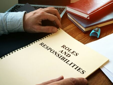 Roles And Responsibilities book on the desk.