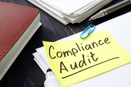Compliance audit concept. Stack of papers in the office. Zdjęcie Seryjne