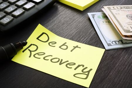 Debt Recovery sign with cash and calculator. Zdjęcie Seryjne