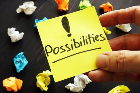 Possiblities sign on memo and paper balls.