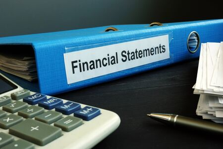 Blue folder with Financial Statements in the office.