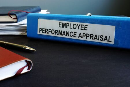 Folder with employee performance appraisal on the desk.