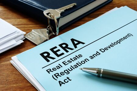 RERA or Real Estate Regulation and Development Act on the desk and key. Zdjęcie Seryjne