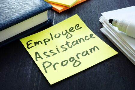 Employee assistance program EAP sign and pile of papers.