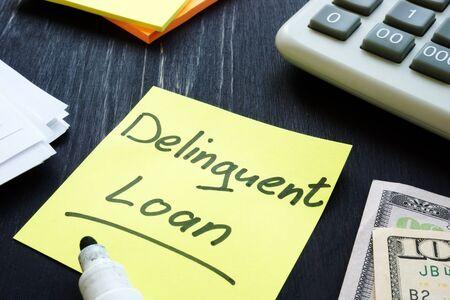 Delinquent loan inscription, calculator and money.