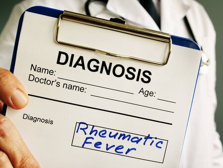 Doctor is holding Rheumatic fever diagnosis.