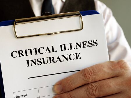 Critical illness insurance application form in the hands.