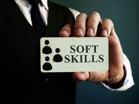 Soft skills sign in the hands of a man.
