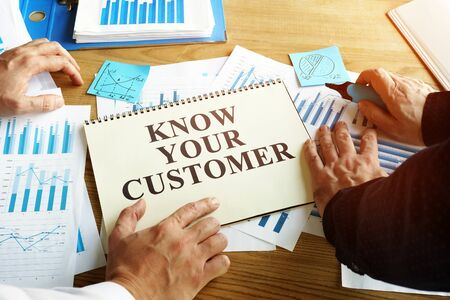 Know your customer sign. Businessmen read marketing report.