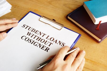 Man holding student loans without cosigner application form. Zdjęcie Seryjne