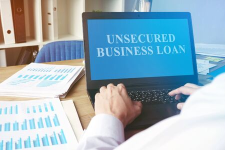 Unsecured Business Loan concept. Man with the laptop.
