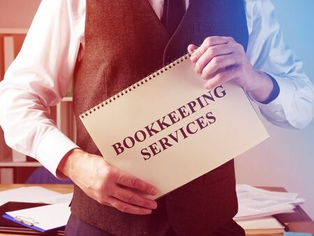 Bookkeeping services sign and accountant in the office. Zdjęcie Seryjne