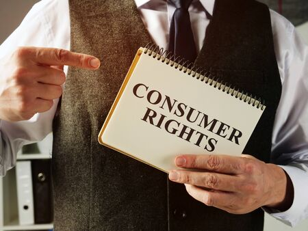 Businessman with consumer rights law in the hands.