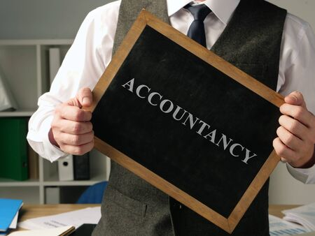 Accountant with inscription accountancy in the office.