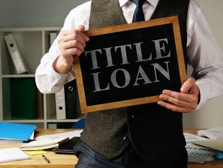 Title Loan inscription in the hands of a man. Zdjęcie Seryjne