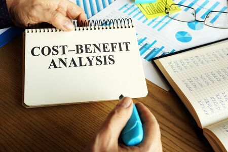 Cost-benefit analysis CBA or BCA on the table. Zdjęcie Seryjne