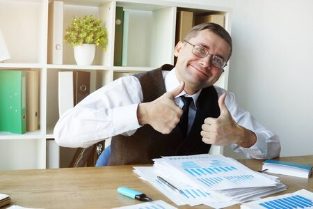 Happy accountant with annual report and business papers.