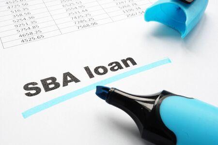 SBA loan underlined words and marker.