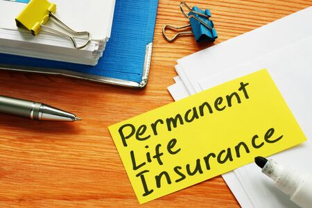 Permanent life insurance form and pen for signing.