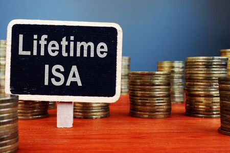 Lifetime ISA Individual Savings Account sign and coins. Banque d'images