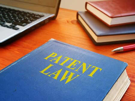 Patent law book about intellectual property on the desk.