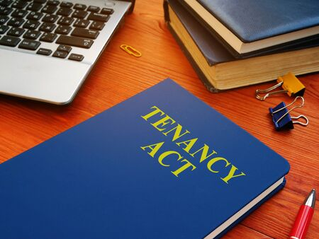 Tenancy Act about renting real estate on the desk.