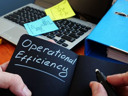 Manager is writing operational efficiency on the sheet.