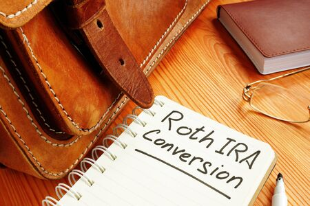 Roth ira conversion memo near retro briefcase and glasses. Stock fotó