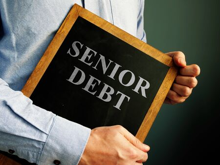 Male is showing Senior Debt sign.