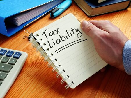 Tax liability reminder in the notepad. Stock Photo