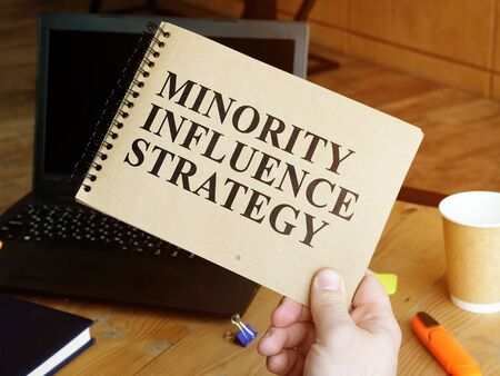 Minority Influence Strategy in the man hands. Stock fotó