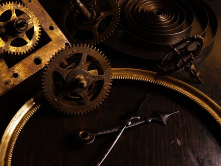 Background from The hands of an old vintage watch, spring and gears. Standard-Bild