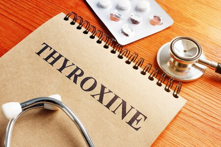 Thyroxine hormone in the notepad and stethoscope. Stock Photo