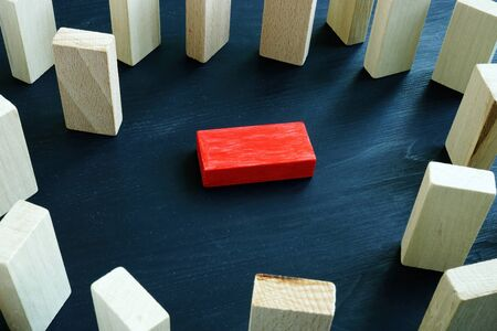 Victimization and discrimination concept. Lying red block and wooden.
