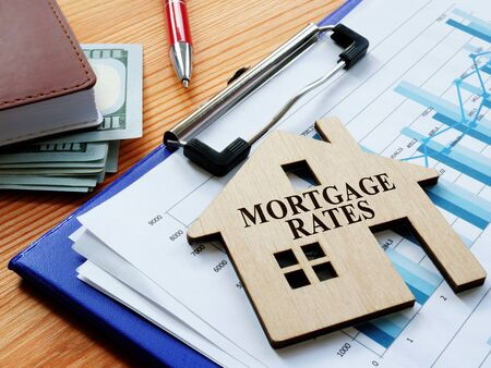 Mortgage rates sign on the home and charts.