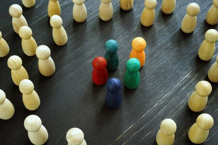 Racism and social exclusion concept. Small group of figures and big one.