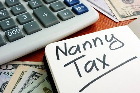 Nanny Tax sign with cash for home budget.