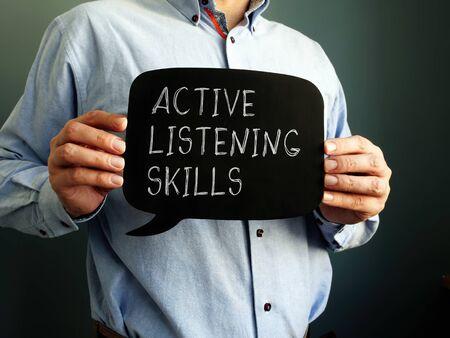 Active Listening Skills handwritten sign on the blackboard.