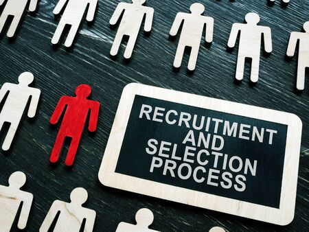 Recruitment and selection process phrase and small figures and red one.