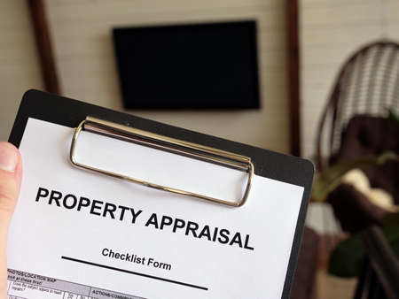 Man Property appraisal checklist form. How much is your home worth. Reklamní fotografie