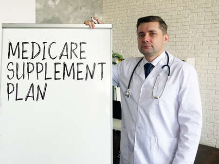 The doctor talks about medicare supplement plan in the clinic. Stock fotó